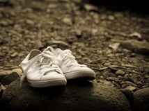 Sneakers on the rocks Royalty Free Stock Photo