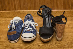 Sneakers and sandals with high heels. Choice of shoes - sneakers or sandals with high heels Stock Photos