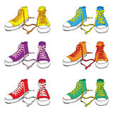 Sneakers set. Different Colors Sneakers With Lovely Heart Stock Photography