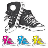 Sneakers set. Vector illustration of pair of sneakers with some color variants stock illustration