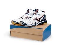 Sneakers on shoe cardboard box Stock Photos