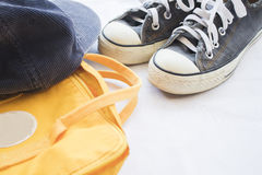 Sneakers shoes black  with yellow bag colorful Stock Photo