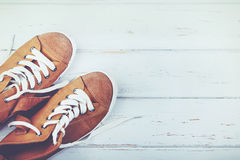 Sneakers. Shoes with laces on a white wooden table Royalty Free Stock Image