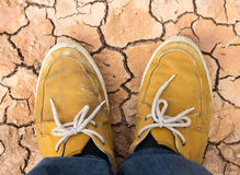 Sneakers shoes walking on Dirty soil top view Stock Photography