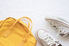 Sneakers shoes and yellow bag colorful Stock Photography