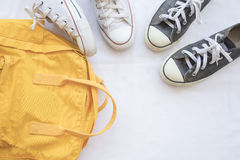 Sneakers shoes and yellow bag colorful Stock Photos