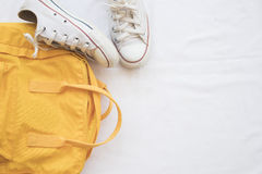 Sneakers shoes and yellow bag colorful Royalty Free Stock Photography