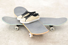 Sneakers on skateboard Royalty Free Stock Photography