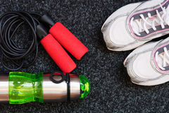 Sneakers, skipping rope and bottle of water Royalty Free Stock Images