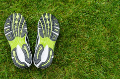 Sneakers soles on grass. With space on right Stock Images