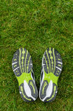 Sneakers soles on grass Royalty Free Stock Images