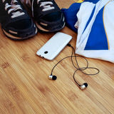 Sneakers and sport equipment Royalty Free Stock Photography