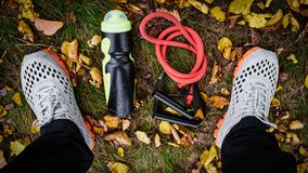 Sneakers and sportive equipment Royalty Free Stock Photography