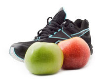 Sneakers, sports shoes and apples Stock Photos