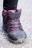 Sneakers Standing on the road .mountain shoes. Black  sneakers Standing on the road Stock Photos