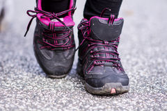 Sneakers Standing on the road .mountain shoes Stock Image