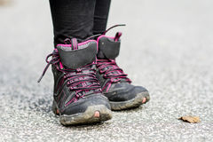 Sneakers Standing on the road .mountain shoes. Black  sneakers Standing on the road Royalty Free Stock Image