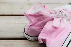 Sneakers for summer. Pink sneakers for summer on a wooden surface Stock Photo