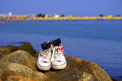 Sneakers and sunglasses Stock Photos