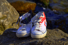 Sneakers and sunglasses Stock Images