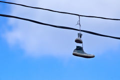 Sneakers on a Telephone Wire Royalty Free Stock Photo