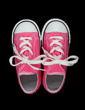 Sneakers (Tennis Shoes) over black Royalty Free Stock Photography