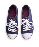 Sneakers. Top view of denim sneakers isolated on white Stock Images