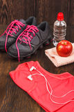 Sneakers, towel and bottle of water Stock Photo