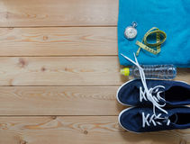 Sneakers. towel bottle of water measure tape and a stopwatch. Royalty Free Stock Image