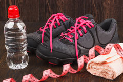 Sneakers, towel and bottle of water Stock Images