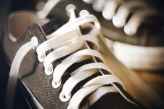 Sneakers with untied white laces royalty free stock photos