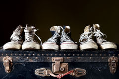 Sneakers on vintage suitcase Royalty Free Stock Image