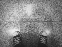 Sneakers vintage tone. Sneakers on the granite background  is vintage tone Stock Photo
