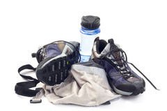 Sneakers with water bottle and vest Royalty Free Stock Photo