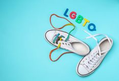 Free Sneakers With Colorful Shoelaces And Abbreviation LGBTQ On Color Background Royalty Free Stock Image - 151367056