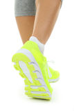 Sneakers on women legs Stock Images