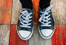 Sneakers on wood deck background Royalty Free Stock Photos
