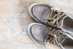 Sneakers on wood teble royalty free stock photos