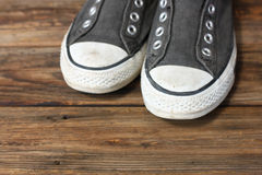 Sneakers on wooden deck. Sneakers on old wooden deck pic stock photography