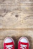 Sneakers on a wooden floor Royalty Free Stock Images
