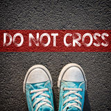 Sneakers and word do not cross Royalty Free Stock Image