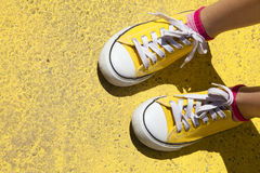 Sneakers on yellow background Stock Image