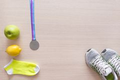 Sneakers, yellow socks, green Apple, yellow lemon, medal, sport Royalty Free Stock Photos