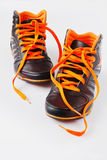 Sneakers. Youth black and orange sneakers on a white background. sport and healthy life concept Stock Image