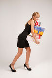 Sneaking with heap of presents Stock Photo
