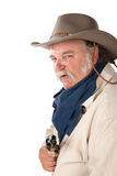 Sneaky Cowboy. Big tough cowboy with pistol on white background Royalty Free Stock Photography