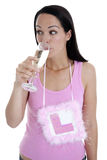 Sneaky drink. Bride to be drinking champagne and wearing L plate celebrating last night of freedom Stock Image