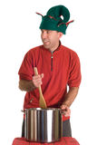 Sneaky Elf. A sneaky elf stirring something into a pot of soup, isolated against a white background Royalty Free Stock Photo
