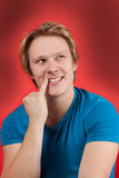 Sneaky and Evil. You man on red background Stock Images