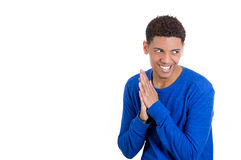 Sneaky evil young guy trying to plot something or screw something up Royalty Free Stock Photography